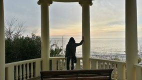 The girl looks at the winter sea. The girl at the rotunda looking at the winter sea, Sochi, Russia Stock Photos