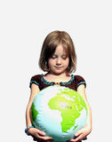 Girl looks at world with wonder. This girl is concerned with our environment on a global level Stock Photo