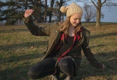 Girl loosing her balance Royalty Free Stock Image