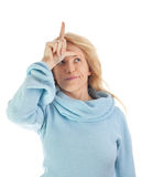 Girl with loser sign Royalty Free Stock Image