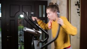 Girl loses strength during training and slides down the sport training machine