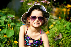 Girl losing her tooth. In a summer time Stock Photo