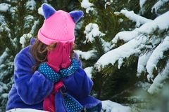 Girl lost in winter forest. lost in the woods and has a frightened face. Child crying in the forest. Lonely girl frozen in snow young nature person background stock images