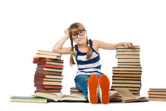 Girl with lot of books. Isolated on white Stock Photos