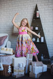 The girl and a lot of boxes with gifts, the joy, the preparation for the holiday, packaging, boxes, Christmas, New Year, lifestyle Royalty Free Stock Photos
