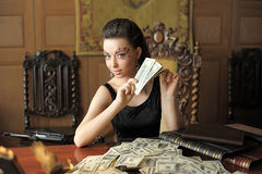 Girl and a lot of dollars Stock Photography