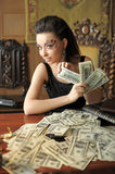 Girl and a lot of dollars Stock Photo