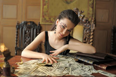 Girl and a lot of dollars Stock Image