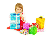 The girl and is a lot of gifts Stock Image