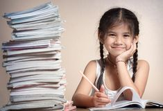 Girl with lot of homework Royalty Free Stock Photo
