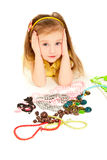 Girl with a lot of jewel lying on the floor Royalty Free Stock Image