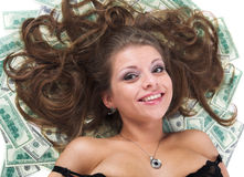 The girl and is a lot of money Stock Photo