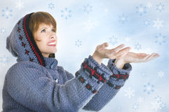 Girl with lots of snowflakes Royalty Free Stock Photos