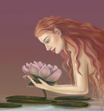 Girl with a lotus Stock Image