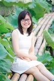 Girl in lotus lake Stock Photos