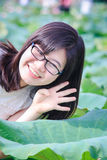 Girl and lotus leaf Royalty Free Stock Image