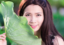 Girl with lotus leaf Royalty Free Stock Images