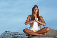 girl in lotus pose Royalty Free Stock Photography
