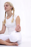 Girl in lotus pose Royalty Free Stock Image