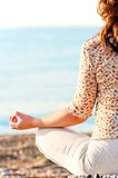 Girl in lotus pose Stock Photos
