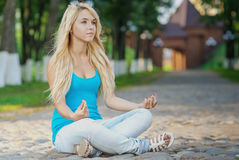Girl in lotus pose Stock Image