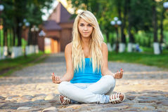 Girl in lotus pose Stock Images