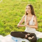 Girl in lotus pose Royalty Free Stock Image