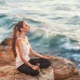 Girl in lotus pose Stock Image