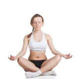 The girl in lotus position Stock Photography