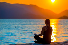 Girl in lotus position admiring Royalty Free Stock Images