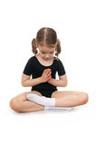 Girl in the lotus position. Children's yoga. Stock Photo