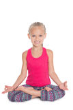 Girl in the lotus position Royalty Free Stock Photo
