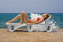 Girl on lounge Royalty Free Stock Photos