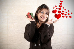 Girl in love. Beautiful indian girl with fruits and hearts royalty free stock photo