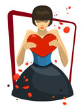 Girl in love. A girl in love, clothed in blue dress with red heart-shaped box in her hand Stock Photo