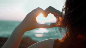 Girl in love enjoying tender moments at sunset during holiday with best friends. Emotional concept of happy exclusive stock footage
