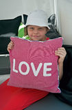 Girl with love pillow Royalty Free Stock Photo