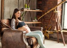 Girl in love pregnant cuddling, waiting for baby.  Royalty Free Stock Photography