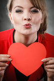 Girl in love with red heart. Love and help from people. Charming lovely woman with red paper heart persuade to be good helpful hopeful. Valentines Day or Royalty Free Stock Photo