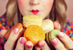Girl Loves Colorful Macaroons Stock Photos