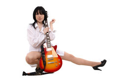 The girl loves a guitar Royalty Free Stock Photos