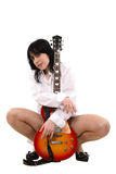 The girl loves a guitar Stock Image