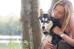 Girl loves her dog Stock Image