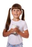 Girl loves milk Stock Images