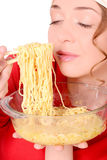 Girl loves pasta. Macaroni, spaghetti, noodles royalty free stock photos