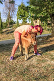 Woman with pony. Young woman hugging a Shetland pony in the countryside Stock Photos