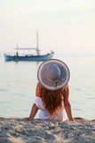 Girl loves the sea. Girl with hat lovely the sun on the beach Stock Photography