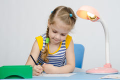 The girl loves to draw with pencils Royalty Free Stock Images