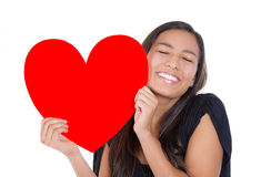 Girl loving a heart Royalty Free Stock Photography