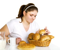 Girl loving rolls Royalty Free Stock Photography